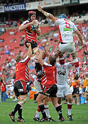 JOHANNESBURG, South Africa, 02 April 2011. Franco van der Merwe of the Lions wins control of the ball from James Horwill (C) of the Reds during the Super15 Rugby match between the Lions and the Reds at Coca-Cola Park in Johannesburg, South Africa on 02 April 2011. .Photographer : Anton de Villiers / SPORTZPICS