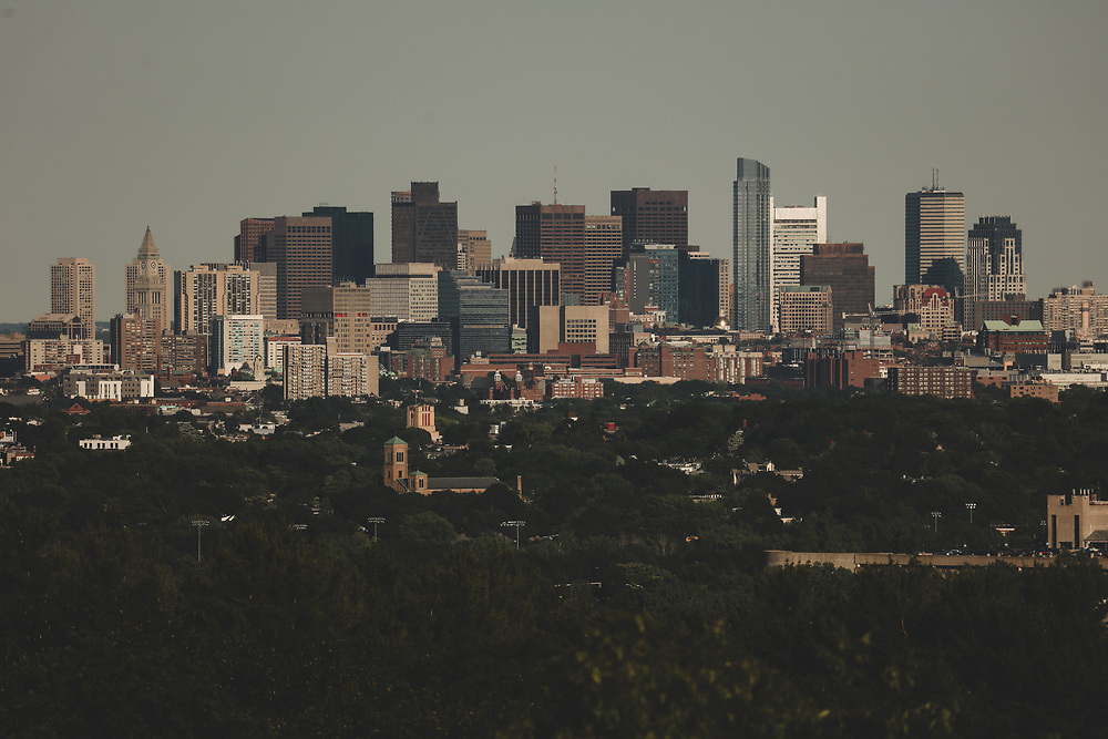 The cityscape of Downtown Boston seen from Arlington on a warm summer afternoon.