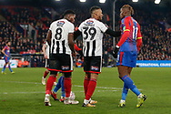 Grimsby Town forward Wes Thomas (39) keeps Crystal Palace forward Wilfried Zaha (11) and Grimsby Town midfielder Mitch Rose (8) apart during the The FA Cup 3rd round match between Crystal Palace and Grimsby Town FC at Selhurst Park, London, England on 5 January 2019.