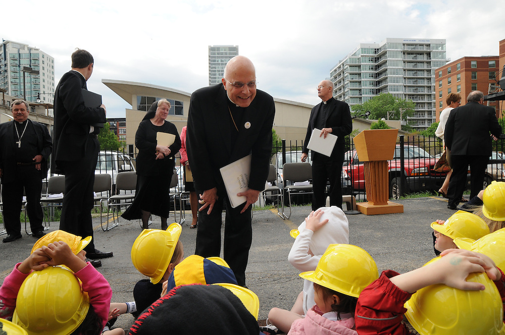 Chicago Archbishop Francis Cardinal George greets students and at the future site of Old St. Mary's Catholic School in Chicago's South Loop neighborhood during a ground breaking ceremony for the new building.
