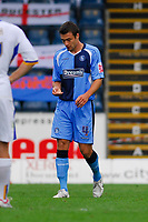 Photo: Leigh Quinnell.<br /> Wycombe Wanderers v Shrewsbury. Coca Cola League 2. 22/09/2007. Wycombes Russell Martin looks at one of his teeth, after it is knocked out in a challenge.
