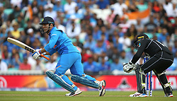 India's MS Dhoni (left) and New Zealand's Tom Blundell during the ICC Cricket World Cup Warm up match at The Oval, London.