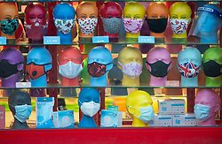 © Licensed to London News Pictures.26/11/2020. Sevenoaks, UK.  Masks for sale in an emporium shop window. People out and about in Sevenoaks High Street in Kent this afternoon. Kent has been placed in tier three as the infection rate is among the worst in England. The health secretary Matt Hancock has announced the new toughened up tier measures today that will come into effect next Wednesday when England's month long lockdown comes to an end. Photo credit:Grant Falvey/LNP