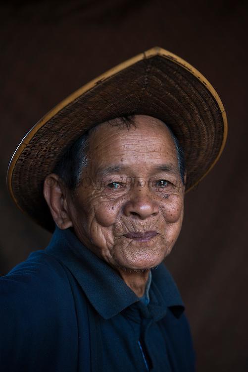 Adi Gallong man & cane hat<br /> Adi Gallong Tribe<br /> Arunachal Pradesh<br /> North East India