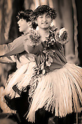 A young male dances the hula with outstretched arms in these photos from Hawaii.