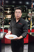 Portrait of Jun Hee Lee chef at l'atelier de Joel Robuchon preparing a dish at MGM Grand Hotel Casino & Resorts in Las Vegas, Nevada, USA