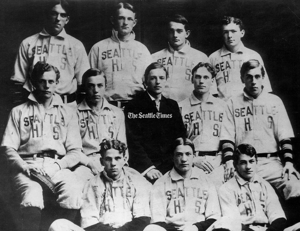 The 12 players on the 1907 Seattle High School touring baseball team were from the left: Top row – Charles Schmutz, pitcher; Jay Smith, second base; Wee Coyle, center field; James Agnew, pitcher | Middle row – Charley Mullen, first base; Ernie Maguire, shortstop; Harold H. Stewart, right field and team manager for the tour; Fred Hickingbottom, left field; Roy Hilton, infielder | Front row – Merton Hemenway, catcher; Harry Martin, third base, and Ten Million, left field. (Seattle Times archives)