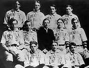 The 12 players on the 1907 Seattle High School touring baseball team were from the left: Top row – Charles Schmutz, pitcher; Jay Smith, second base; Wee Coyle, center field; James Agnew, pitcher   Middle row – Charley Mullen, first base; Ernie Maguire, shortstop; Harold H. Stewart, right field and team manager for the tour; Fred Hickingbottom, left field; Roy Hilton, infielder   Front row – Merton Hemenway, catcher; Harry Martin, third base, and Ten Million, left field. (Seattle Times archives)
