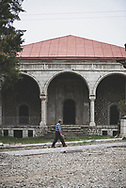 """An Armenian man walks past the Yukhari (""""Upper"""") Govhar Agha Mosque in Shushi, Nagorno-Karabakh. The mosque was completed in 1885. During the Soviet period, beginning in 1969, it served as the town museum.<br /><br />(September 23, 2016)"""