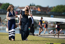 © London News Pictures. 05/07/2012.  Henley-on-Thames, UK. Spectators enjoy the sunshine on Day three of Henley Royal Regatta on the River Thames at Henley-on-Thames, Oxfordshire on July 03, 2013. The 5 day regatta over the first weekend in July, races head-to-head knock out competitions over a course of 1 mile between rowing teams from throughout the world. Photo credit: Ben Cawthra/LNP