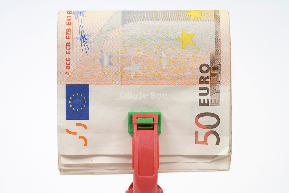 stack of 50 Euro bills in a clamp
