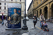 Modern Italian family and Agnolo de Cosimo Bronzino's painting of the Medici Eleanora of Toledo and son Giovanni C1545..Eleonora di Toledo (1522 - 1562), the daughter of Don Pedro Álvarez de Toledo, the Spanish viceroy of Naples. Her face is still familiar to many because of her solemn and distant portraits by Agnolo Bronzino. She provided the Medici with the Pitti Palace  and seven sons to ensure male succession and four daughters to connect the Medici with noble and ruling houses in Italy. She was a patron of the new Jesuit order, and her private chapel in the Palazzo Vecchio  was decorated by Bronzino, who had originally arrived in Florence to provide festive decor for her wedding. She died, with her sons Giovanni and Garzia, in 1562, when she was only forty; all three of them were struck down by malaria while traveling to Pisa.