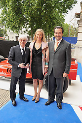 Left to right, BERNIE ECCLESTONE, and Mr & Mrs António Horta-Osório, Abbey National plc chief executive at the F1 Party in aid of the Great Ormond Street Hospital Children's Charity held at the V&A, Londonon 17th June 2009.