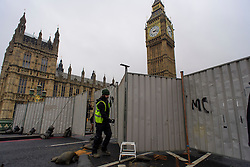 © Licensed to London News Pictures. 31/12/2016. London, UK. Steel barriers being put in place to close off Westminster Bridge in London, in front of the Houses of Parliament, ahead of tonight's New Year celebrations. Security surrounding this year's event has been heightened following a terrorist attack at a Christmas market in Berlin earlier this month. Photo credit: Ben Cawthra/LNP