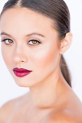 Portrait of Young Woman with Dark red Lips
