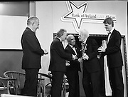 """B.O.I. GAA Allstars  (R96)..1989..03.02.1989..02.03.1989..3rd February 1989..The Awardsfor the B.O.I.Allstars were held tonight in the Burlington Hotel,Dublin. The list of the winnersis as follows..1989 - HURLING ALL STARS J. Commins (Galway), A. Fogarty (Offaly), E. Cleary (Wexford), D. Donnelly (Antrim), Conal Bonnar (Tipperary), B. Ryan (Tipperary), S. Treacy (Galway), M. Coleman (Galway), D. Carr (Tipperary), E. Ryan (Galway), Joe Cooney (Galway), O. McFetridge (Antrim), P Fox (Tipperary), Cormac Bonnar (Tipperary), N. English (Tipperary)."""" 1989 - FOOTBALL ALL STARS Gabriel Irwin (Mayo), Jimmy Browne (Mayo), Gerry Hargan (Dublin), Dermot Flanagan (Mayo); Connie Murphy (Kerry), Conor Counihan (Cork), Anthony Davis (Cork); Teddy McCarthy (Cork), Willie Joe Padden (Mayo); Dave Barry (Cork) Larry Tompkins (Cork), Noel Durkin (Mayo); Paul McGrath (Cork), Eugene McKenna (Tyrone), Tony McManus (Roscommon).""""..Image shows Paddy collins receiving his award as all time hurling allstar. John Dowling, President of the GAA is presenting the award as An Taoiseach, Charles Haughey and Frank O'Rourke, Deputy Chief Executive, Bank of Ireland look on."""