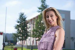 Smiling pretty attractive blond woman outdoors