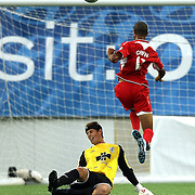 Goalkeeper Kyle Polak makes a save against Orlando City Lions Forward Maxwell Griffin (11)during a United Soccer League Pro soccer match between the Wilmington Hammerheads and the Orlando City Lions at the Florida Citrus Bowl on June 18, 2011 in Orlando, Florida.  (AP Photo/Alex Menendez)