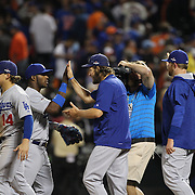 Pitcher Clayton Kershaw, Los Angeles Dodgers, celebrates victory with teammates  during the New York Mets Vs Los Angeles Dodgers, game four of the NL Division Series at Citi Field, Queens, New York. USA. 13th October 2015. Photo Tim Clayton