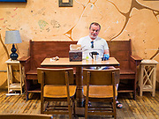 15 MAY 2020 - DES MOINES, IOWA: JIM COWGER sits by himself in Java Joe's, a reopened coffee shop in downtown Des Moines. The Governor of Iowa allowed most businesses in Iowa to reopen today, including restaurants, barbershops, coffee shops and malls. Restaurants are supposed to be working at 50% of normal capacity and barbershops are urged to take reservations and not allow customers to wait in the shop. Movie theaters, bars, museums, zoos, and casinons are still closed. On Friday, 15 May, Iowa reported 14,049 cases of COVID-19 and 336 deaths from disease since the start of the pandemic. Iowa's total number of infections continue to rise and several communities in Iowa have emerged as national hotspots for the spread of Coronavirus (SARS-CoV-2).         PHOTO BY JACK KURTZ