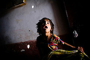 Shazhia, 7, is standing inside her home in Nawab, one of the water-affected colonies near the abandoned Union Carbide (now DOW Chemical) industrial complex in Bhopal, Madhya Pradesh, India, site of the infamous 1984 gas tragedy. The poisonous cloud that enveloped Bhopal left everlasting consequences that today continue to consume people's lives.
