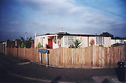 The Catford prefabs estate in South London, 2004. Thousands of post-war prefabs are still being lived in and cherished by their tenants or owners all over the UK. I  love prefabs. Some people will think living in a prefab is like living in a box. Yes, it might sound or even look a bit like that but what a lovely, sophisticated box! I am talking about post-war prefabs, erected in a hurry just after the war when Britain was suffering an unprecedented housing shortage. More than 150 000 of these prefabricated houses were erected all over the UK mainly ins small estates. They were luxury to most of the residents who mainly were service men coming back from the war and reuniting with their family. Their prefab became their little castle with all mod cons and even more than any working class could hope for at the time: hot water, toilets inside, a fitted kitchen with a gas fridge and a garden all around the house. Part of the temporary housing programme, they were not supposed to last over a decade. Yet, over 70 years later, a few Thousands are still standing and very much loved.<br />