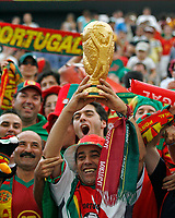 Photo: Glyn Thomas.<br />Portugal v Iran. Group D, FIFA World Cup 2006. 17/06/2006.<br /> Portugal fans with a replica of the World Cup.