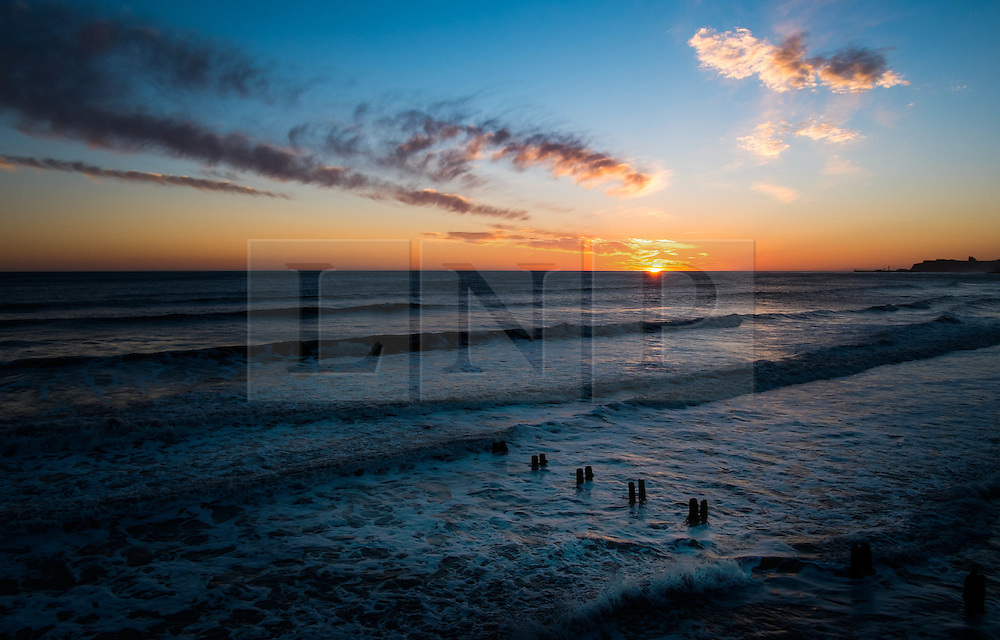 © Licensed to London News Pictures. 17/03/2014<br /> <br /> Sandsend, England <br /> <br /> A new day begins as the sun rises in Sandsend near Whitby in North Yorkshire.<br /> <br /> Photo credit : Ian Forsyth/LNP