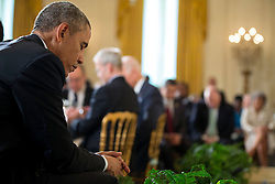President Barack Obama bows his head during the closing prayer at the Easter Prayer Breakfast in the East Room of the White House, April 7, 2015. (Official White House Photo by Pete Souza)<br /> <br /> This official White House photograph is being made available only for publication by news organizations and/or for personal use printing by the subject(s) of the photograph. The photograph may not be manipulated in any way and may not be used in commercial or political materials, advertisements, emails, products, promotions that in any way suggests approval or endorsement of the President, the First Family, or the White House.