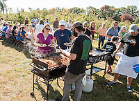 """Jillian Fox and her father Jon Hildreth enjoy their """"Breakfast in the Orchard"""" on Sunday morning as Glenn LeClair and Chef Kevin Halligan and crew serve up at Smith's Orchard in Belmont.  (Karen Bobotas/for the Laconia Daily Sun)"""