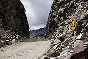 The Portachuelo Pass (15,639 feet / 4767 meters) road cuts deeply through rock in Huascaran National Park (UNESCO World Heritage Site), Cordillera Blanca, Andes Mountains, Peru, South America