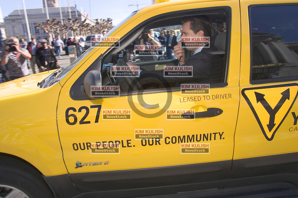 San Francisco Mayor Gavin Newsom today  takes a test drive as he welcomes ten  2005 Ford Escape Hybrid taxis to his city's Yellow Cab fleet, the first hybrid SUV taxi fleet in use in the United States. The gasoline-electric hybrid SUVs deliver an EPA-certified 36 mpg in city driving, and 31 mpg in highway use, which will save San Francisco's Yellow Cab Cooperative thousand of dollars over the life of the vehicles. The Escape Hybrid also meets the stringent requirements for AT-PZEV emissions status, making it  the cleanest SUV on the road.  Photo by  Kim Kulish