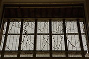A view through a window inside HM Prison Brixton, a local men's prison located in Brixton in the borough of Lambeth in South London on the 26th of July 2016, London United Kingdom. The prison originally opened as the Surrey House of Correction in 1820 and now has a capacity of 800 men living across 5 different wings. A, B, C, D and G, G wing houses vulnerable men. (photo by Andy Aitchison)