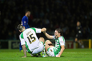 Shane Duffy (L) and Luke Ayling (R) of Yeovil Town share a joke after colliding during the Skybet Championship match, Yeovil Town v Leicester City at Huish Park Stadium in Yeovil on Tuesday 1st October 2013. Picture by Sophie Elbourn, Andrew Orchard Sports Photography,