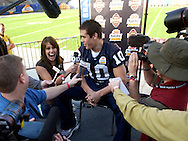 """Notre Dame quarterback Brady Quinn is interviewed by his sister Laura Quinn during media day for the Fiesta Bowl yesterday in Tempe, AZ. Laura, working for ESPN, asked her brother what the biggest distraction of the week was, and he simple reply was, """"You."""" Laura is dating Ohio State linebacker A.J. Hawk."""