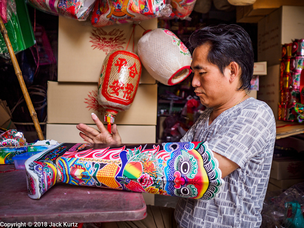 22 DECEMBER 2018 - CHANTABURI, THAILAND: A man makes paper boots for a temple in Chantaburi. Chantaburi is the capital city of Chantaburi province on the Chantaburi River. Because of its relatively well preserved tradition architecture and internationally famous gem market, Chantaburi is a popular weekend destination for Thai tourists.         PHOTO BY JACK KURTZ