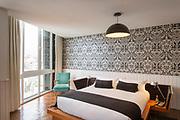 Bed in hotel bedroom, Hotel Palacio Astoreca, Valparaiso, Chile