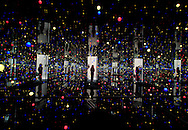 """A visitor looking at """"Gleaming Lights of the Soul"""" a mixed media installation by veteran Japanese artist Yayoi Kusama, on display at Pilkington's one of the venues for the 2008 Liverpool Biennial, the UK's largest contemporary international arts festival. The Biennial commenced on September 20 and runs until the end of November. Liverpool was also 2008 European Capital of Culture."""
