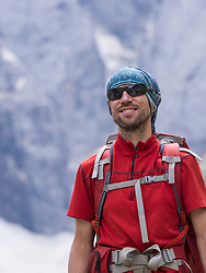 Man hiking in the High Pyrenees in front of mount Vignemale, Cauterets, France