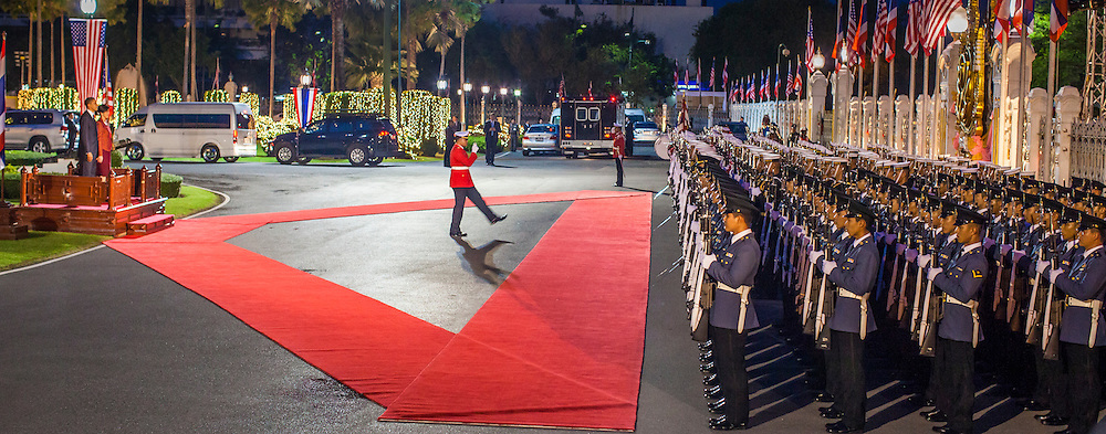 18 NOVEMBER 2012 - BANGKOK, THAILAND:  The commander of the Honor Guard presents the Guard to US President Barack Obama and Thai Prime Minister Yingluck Shinawatra during a welcoming ceremony for President Obama at Government House in Bangkok. Barack Obama will become the first US President to visit Myanmar during the four-day tour of Southeast Asia that will also include visits to Thailand and Cambodia.  PHOTO BY JACK KURTZ