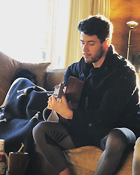 """Nick Jonas releases a photo on Twitter with the following caption: """"""""Quiet New Years morning. 🎶 📸 @PapaJonas"""""""". Photo Credit: Twitter *** No USA Distribution *** For Editorial Use Only *** Not to be Published in Books or Photo Books ***  Please note: Fees charged by the agency are for the agency's services only, and do not, nor are they intended to, convey to the user any ownership of Copyright or License in the material. The agency does not claim any ownership including but not limited to Copyright or License in the attached material. By publishing this material you expressly agree to indemnify and to hold the agency and its directors, shareholders and employees harmless from any loss, claims, damages, demands, expenses (including legal fees), or any causes of action or allegation against the agency arising out of or connected in any way with publication of the material."""