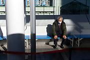 senior businessman sitting alone on a bench Japan Tokyo