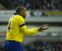 Photo. Andrew Unwin.Digitalsport<br /> Blackburn Rovers v Arsenal, Barclaycard Premier League, Ewood Park, Blackburn 13/03/2004.<br /> Arsenal's Thierry Henry pleads innocent after stealing the ball from Brad Friedel.