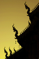 Chiangmai Temple Sunset Silhouette, with highlighted dragons or nagas in the golden sky.