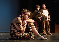 "Simba (Jesse Powers) meets up with Pumbaa (Sam Leggett) and Timon (Julie Auld) during dress rehearsal for Gilford Middle School's production of ""The Lion King"" on Monday afternoon.  (Karen Bobotas/for the Laconia Daily Sun)"