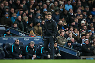Maurcio Pochettino (Tottenham Hotspur) watches the game during the Barclays Premier League match between Manchester City and Tottenham Hotspur at the Etihad Stadium, Manchester, England on 14 February 2016. Photo by Mark P Doherty.