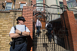 © Licensed to London News Pictures. 19/06/2017. London, UK. Police standing outside Finsbury Park Mosque . One man is known to be dead and several inured after a hired van was driven in to people on Whadcoat Street in Finsbury Park in North London after late night prayers at a nearby mosque . Photo credit: Joel Goodman/LNP