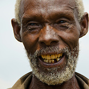 An elderly gentleman poses for a portrait in Rulindo District, Rwanda..