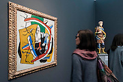 Work by Fernand leger next to a 15th century statue - Frieze Masters London 2015, Regents Park, London. It covers several thousand years of art from 130 of the world's leading modern and historical galleries. The vetted artworks spanning antiquities, Asian art, ethnographic art, illuminated manuscripts, Medieval, modern and post-war, Old Masters and 19th-century, photography, sculpture and Wunderkammer are brought together in a singular space designed by Anabelle Selldorf.  The fair is open to the public 14–17 October.