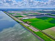 Nederland, Noord-Holland, gemeente Hollands Kroon, 07-05-2021; Polder Wieringermeer, Wieringerwerf. Zuiderdijkweg met het dijkmagazijn in de voorgrond. Kassen van Agriport A7 in het verschiet, Medemblik uiterst link aan de horizon.<br /> Polder Wieringermeer, Wieringerwerf. Zuiderdijkweg met het dijkmagazijn in de voorgrond. Kassen van Agriport A7 in het verschiet, Medemblik uiterst link aan de horizon.<br /> luchtfoto (toeslag op standard tarieven);<br /> aerial photo (additional fee required)<br /> copyright © 2021 foto/photo Siebe Swart